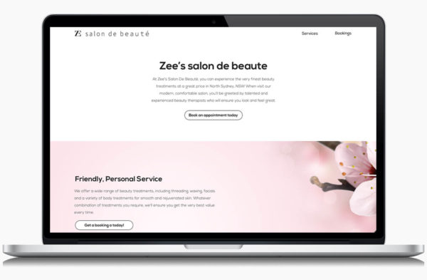 Zee's Salon De Beaute designed website on a laptop