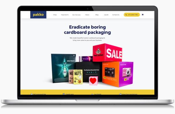 Pakko's designed website on a laptop